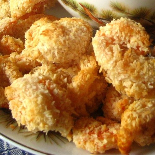 lots of baked coconut shrimp on a plate