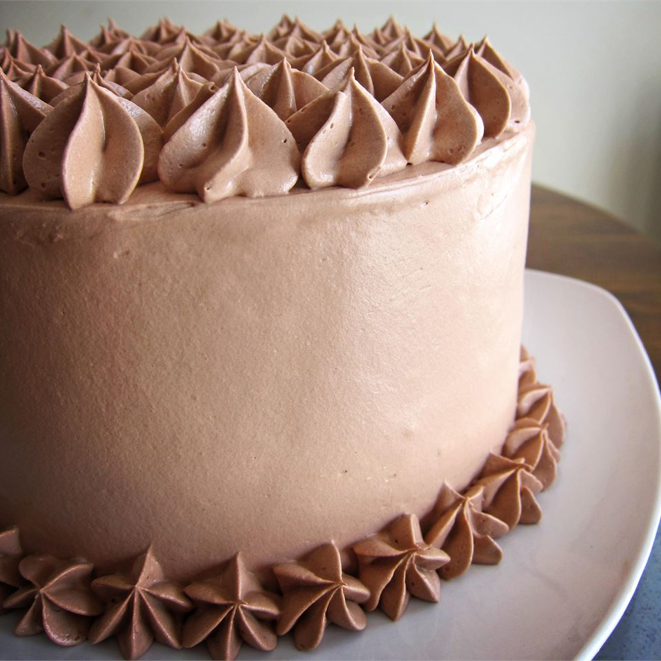 a frosted cake with a light cocoa frosting