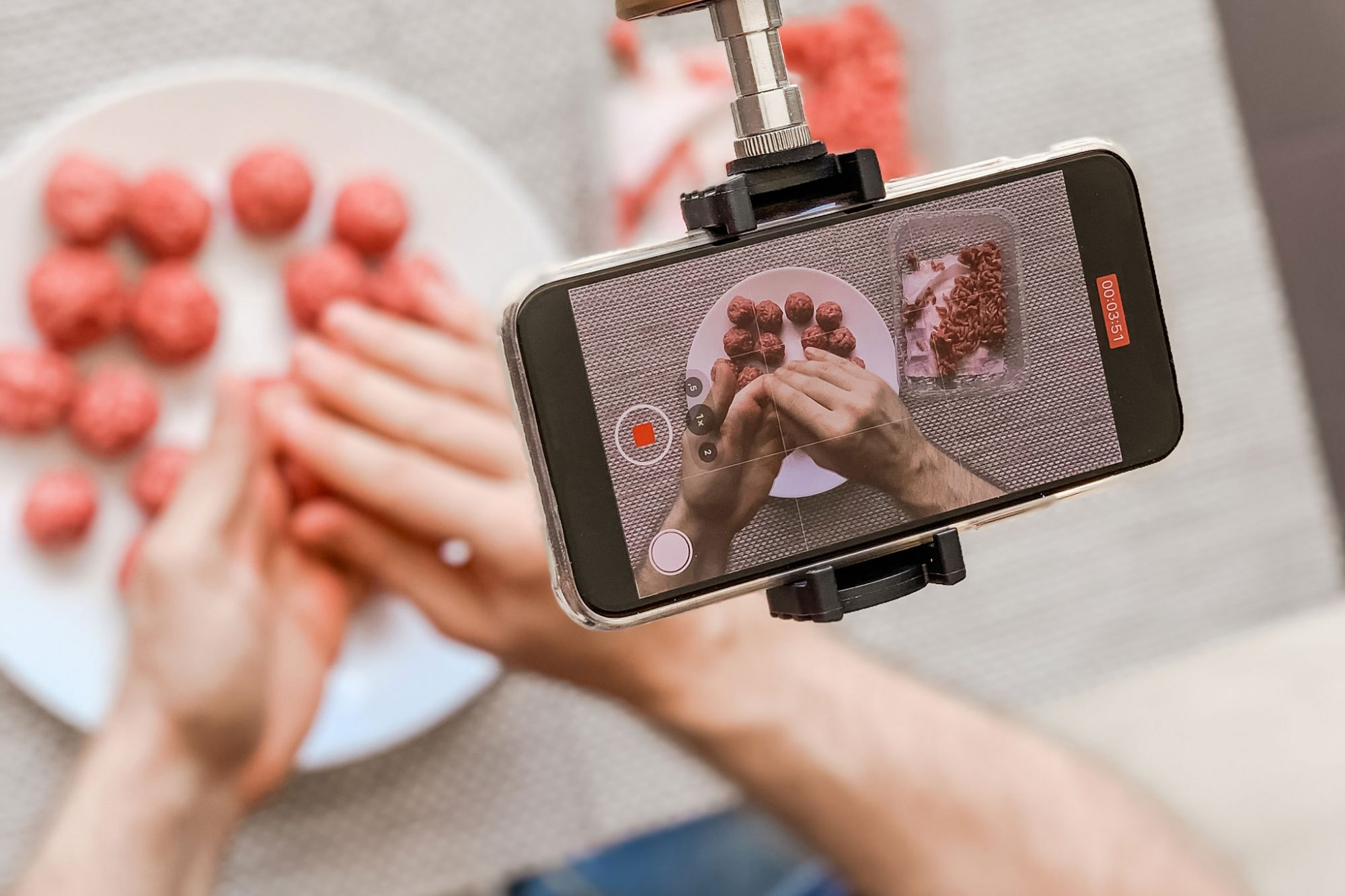 somebody making meatballs and filming it on an iphone