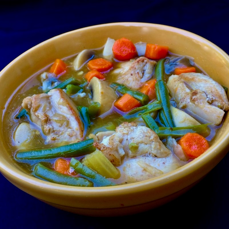 bowl of chicken stew with veggies