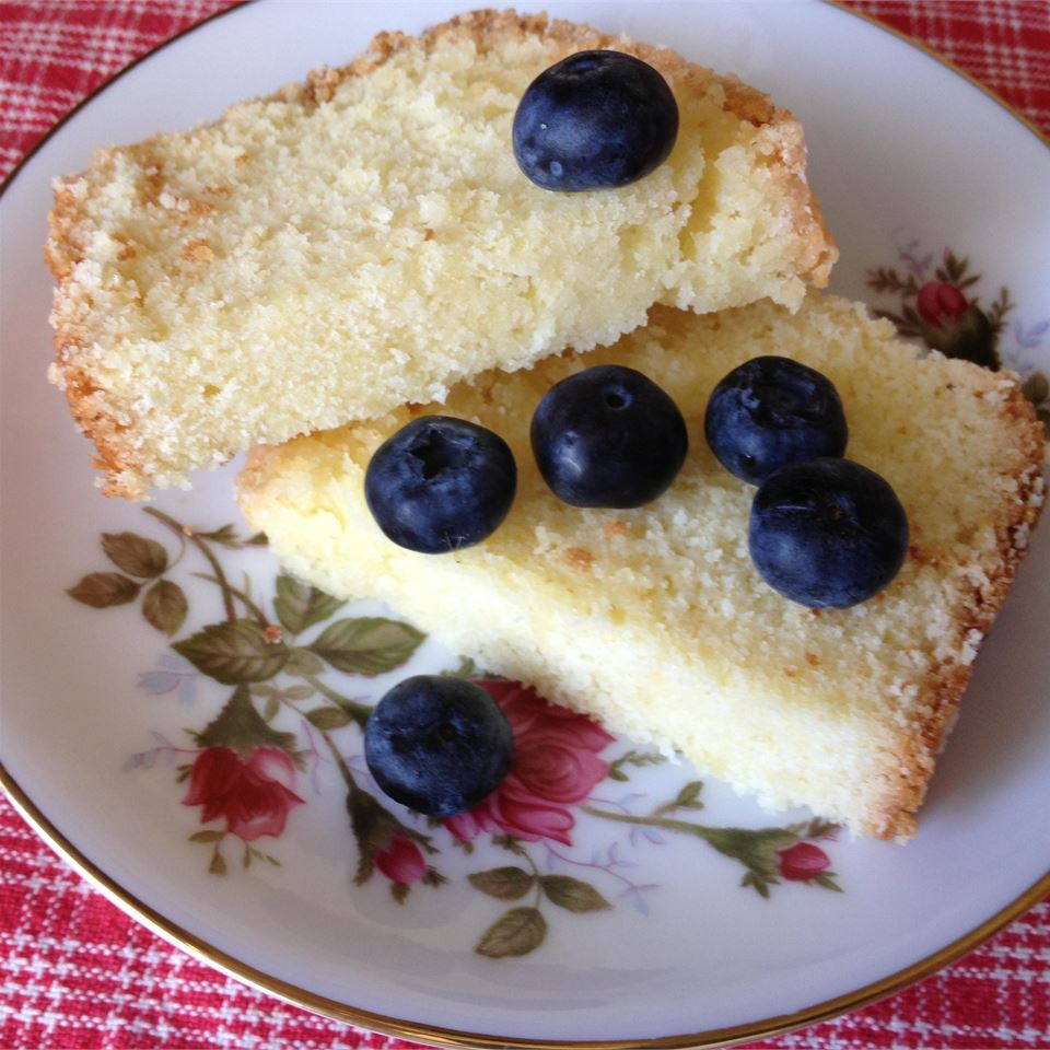 two slices of lemon cake on a plate with blueberries on top