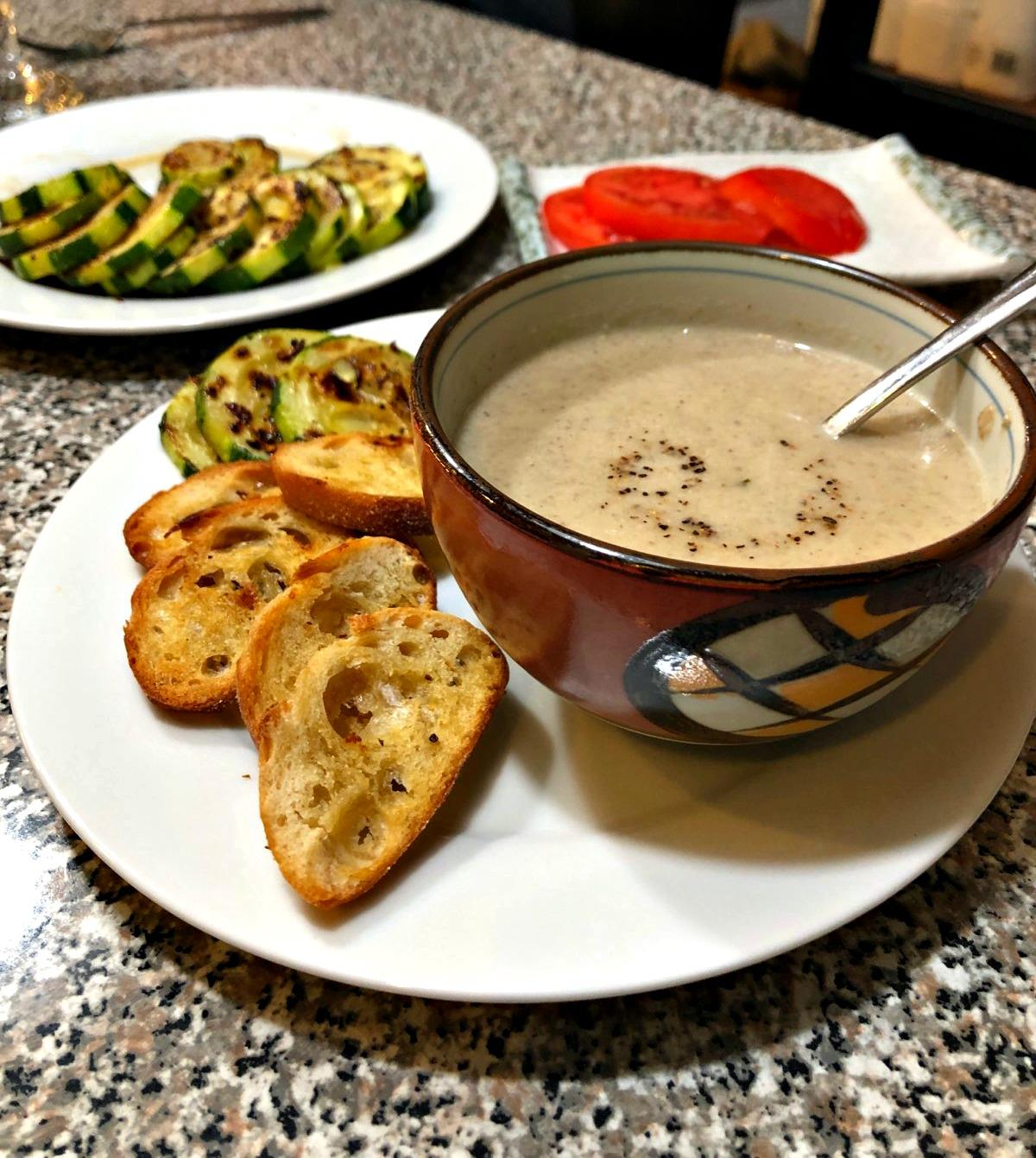 creamy mushroom soup with toasted bread and Brussel sprouts