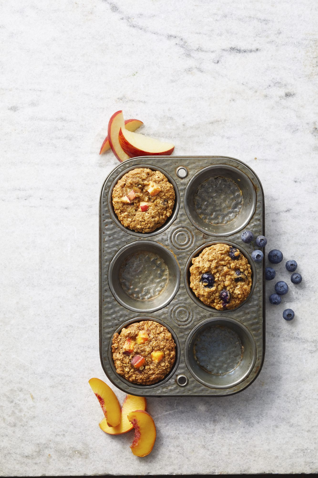 assorted fruit spice muffins in tin