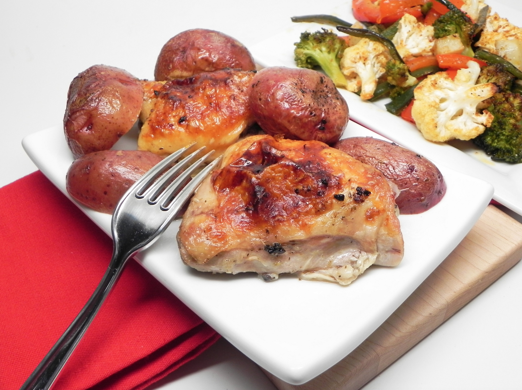 """This simple Greek chicken and potato bake is a great family dinner,"" says recipe creator Virginia Vohasek. ""Chicken thighs are marinated in a garlic-lemon marinade and then baked in the oven."""