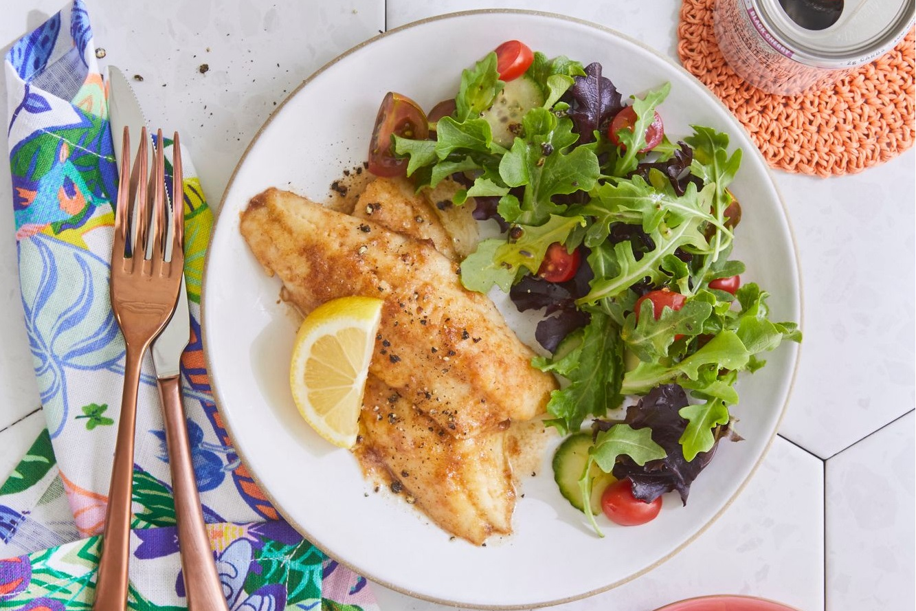 overhead shot of brown butter perch served with green salad
