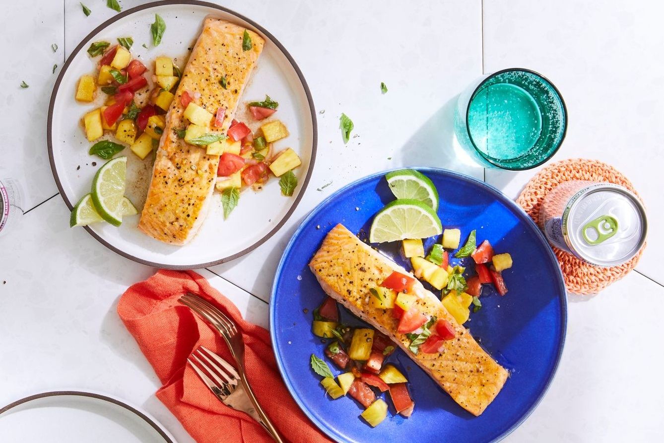 salmon filets served with tomato and pineapple salsa