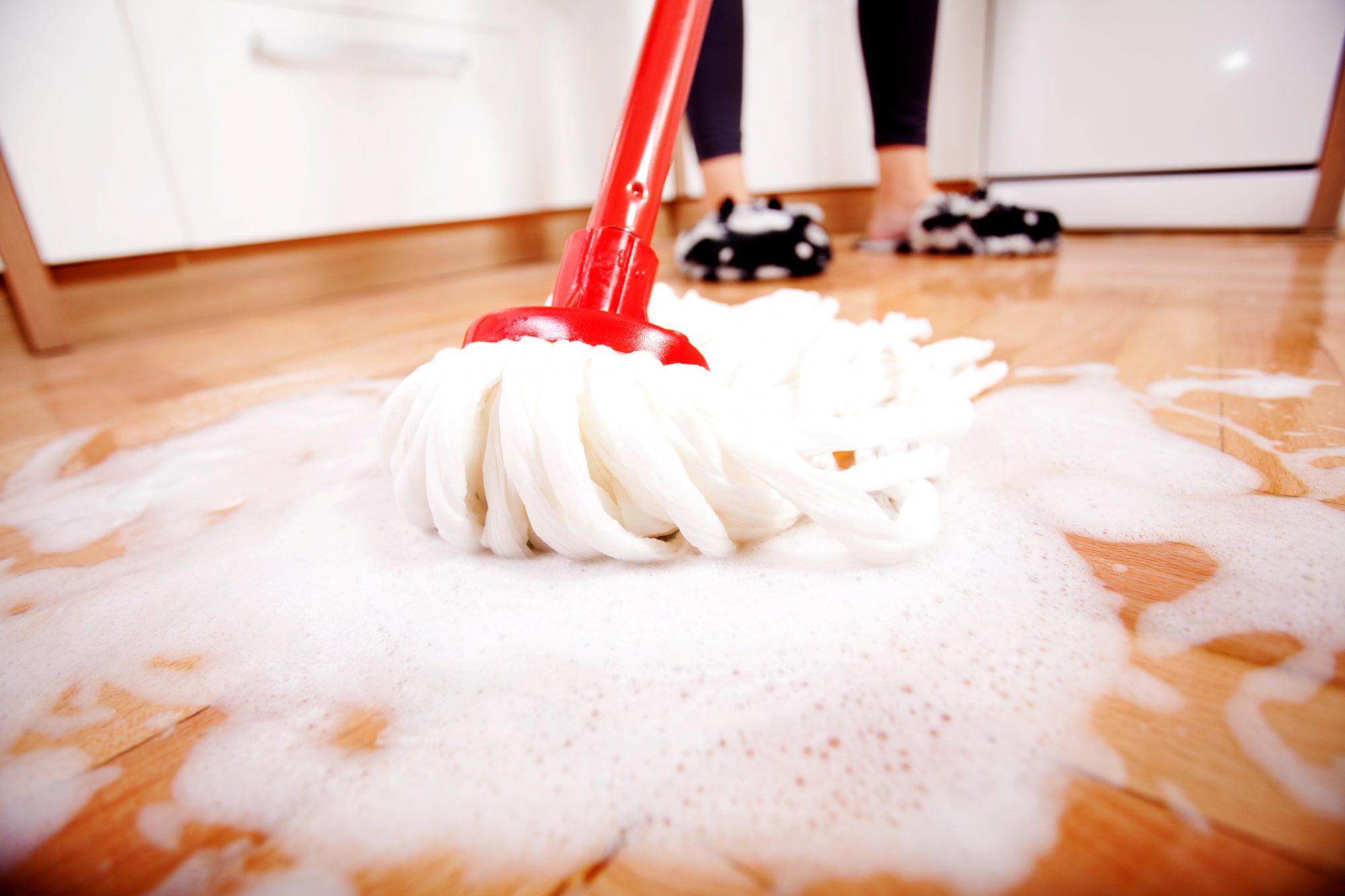 Woman mopping a wooden floor