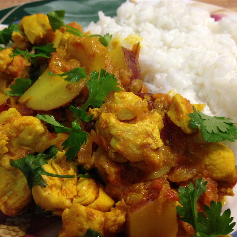 Bengali Chicken Curry with Potatoes on a blue plate