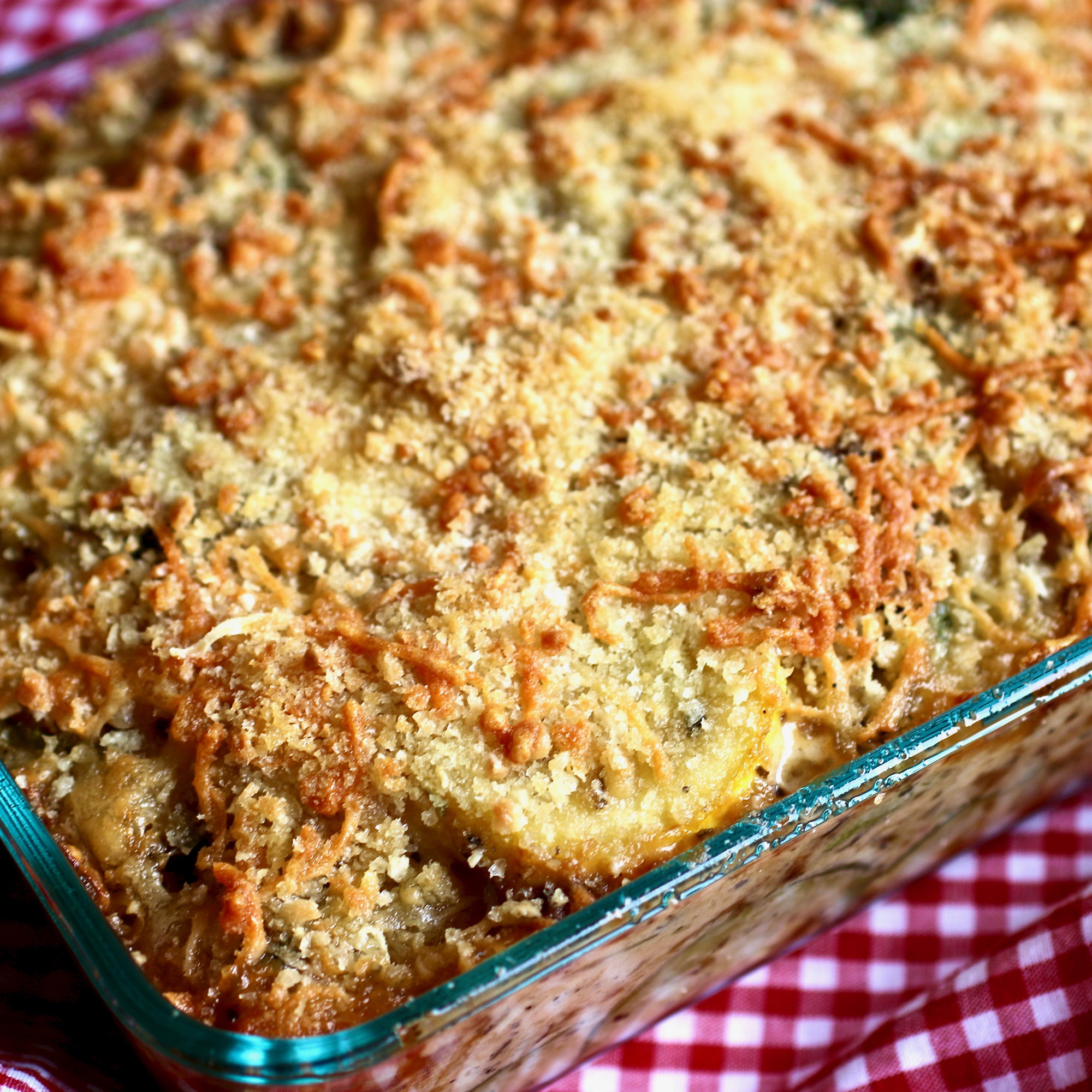 gratin in glass casserole dish on picnic blanket