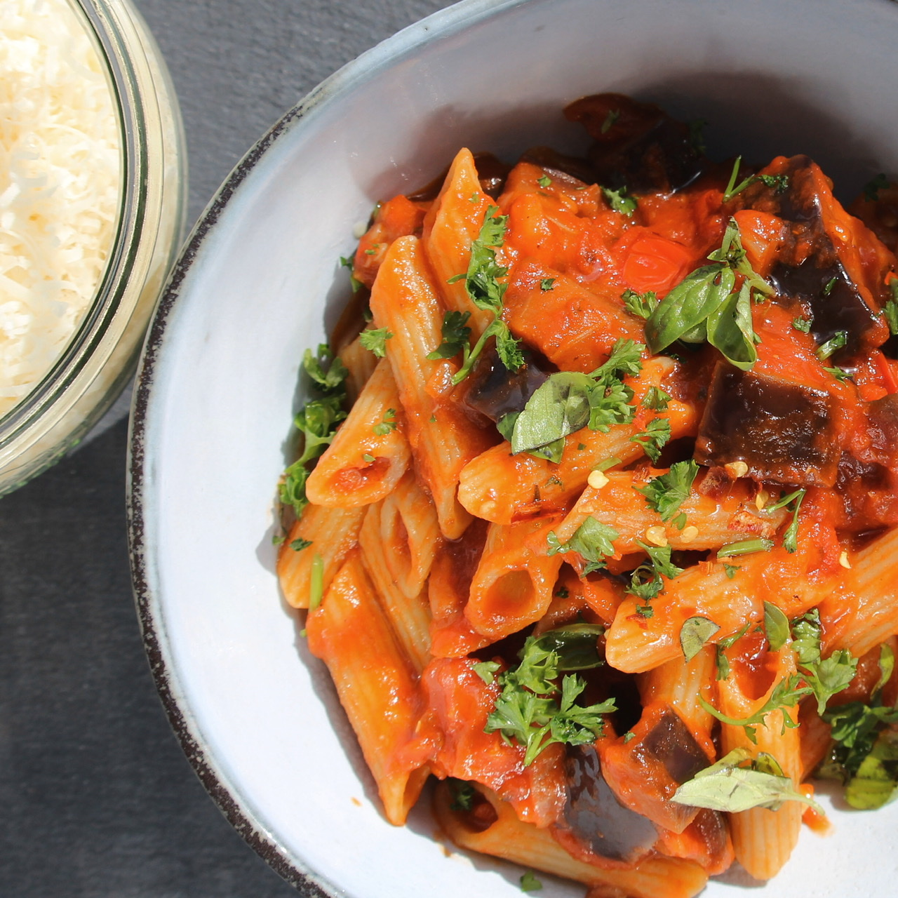Spicy Eggplant and Pasta with Pancetta in a white bowl