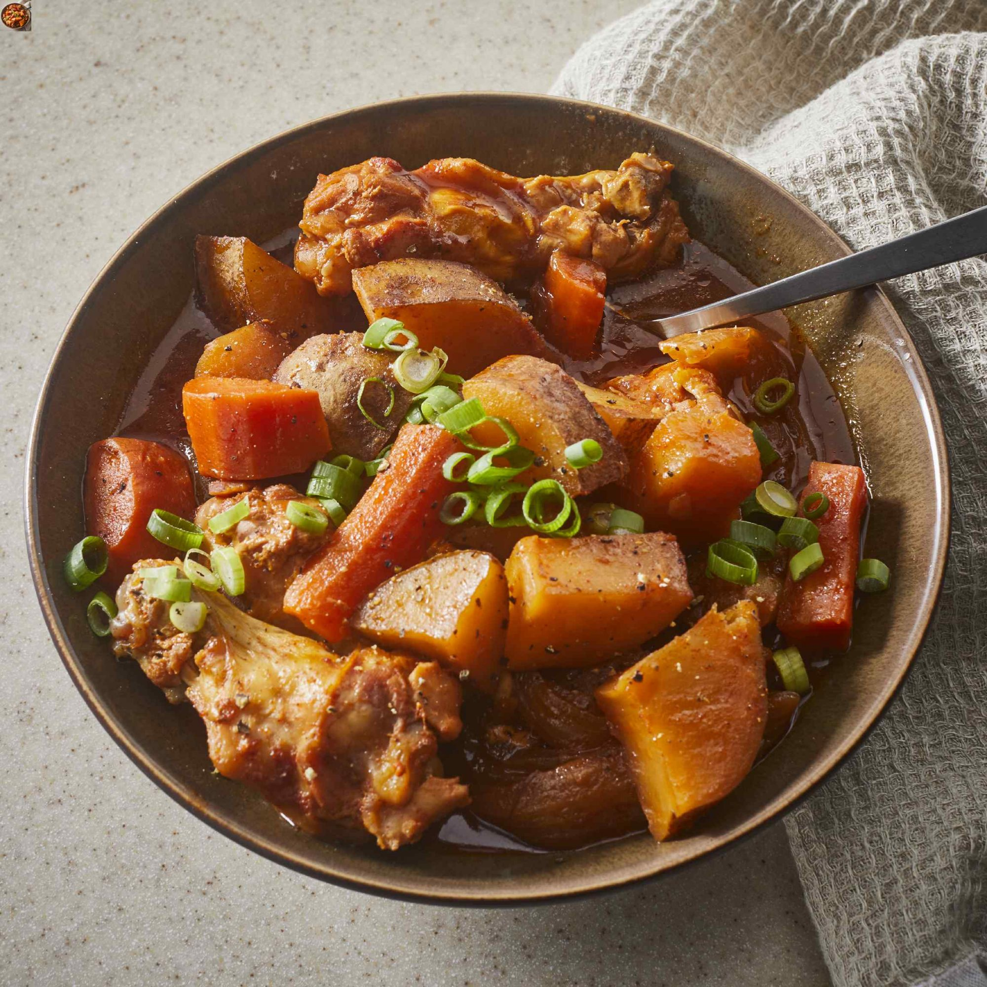 Korean Spicy Chicken and Potato in a brown bowl