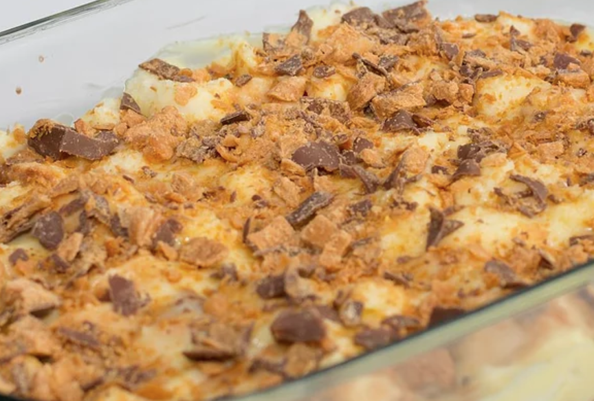 Make this bread pudding-inspired treat with just five ingredients: angel food cake, milk, two packages of instant pudding mix, and Butterfinger candy bars.