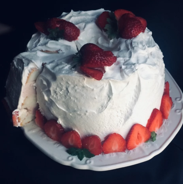 Angel food cake layered with strawberry ice cream is simply delicious. Decorate with strawberries and mint leaves for a gorgeous, perfect-for-summertime presentation.