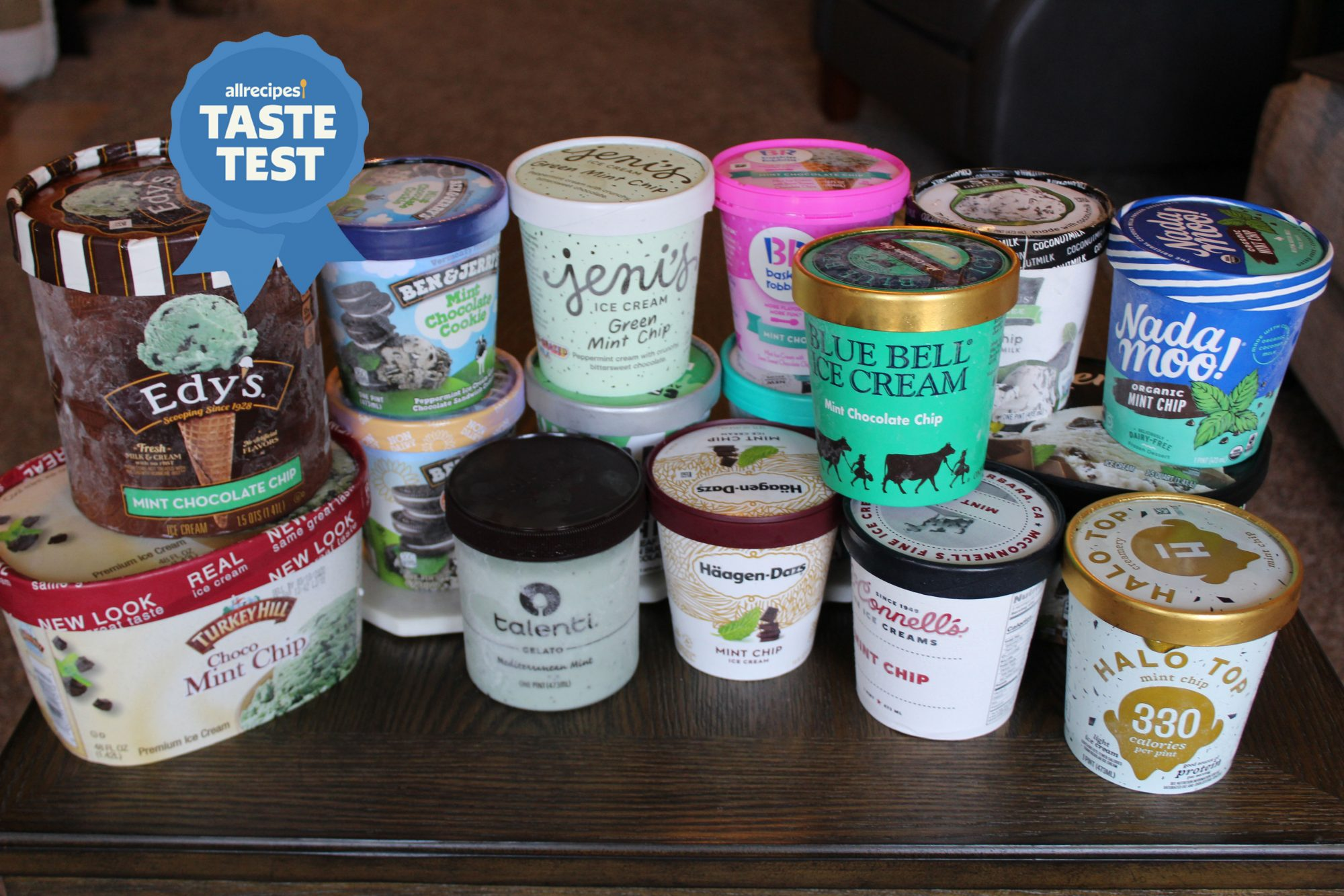 16 different pints of mint chocolate chip ice cream on table with allrecipes taste test ribbon