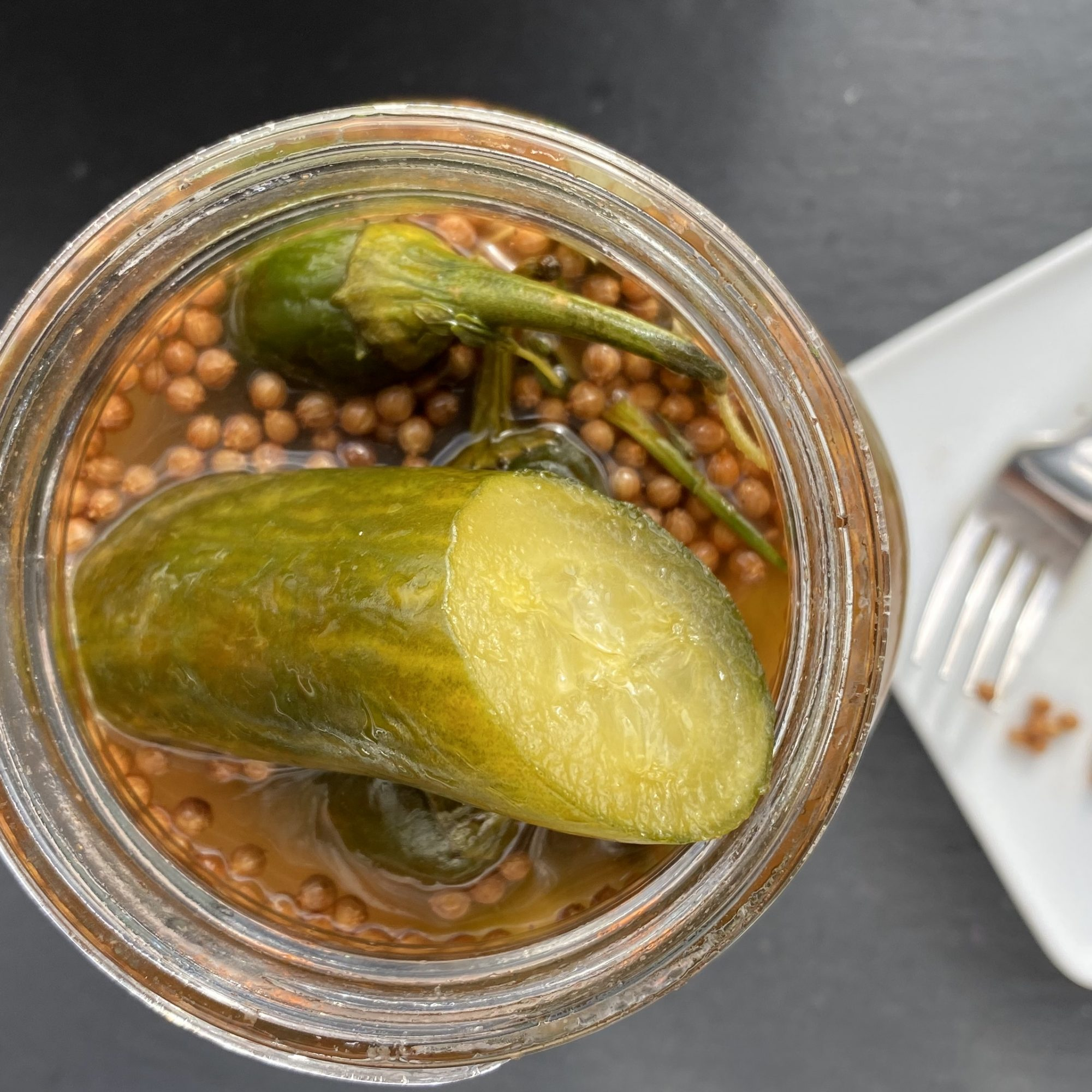 """These are half-sour pickles spiced with harissa and all the traditional components of Turkish za'atar,"" says veithk. ""The toasted cardamom adds a citrusy finish to these very bold pickles. After 10 days, they will continue to improve with age."""