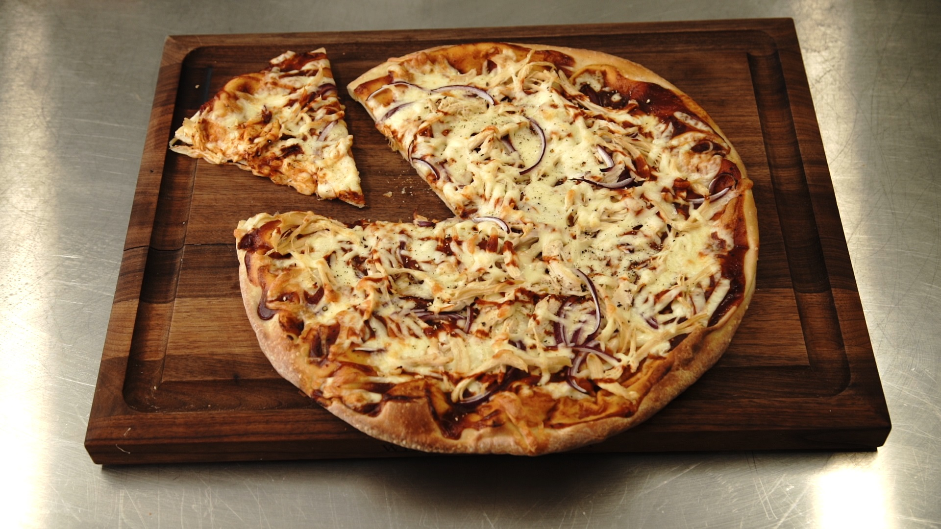 bbq chicken pizza on a cutting board