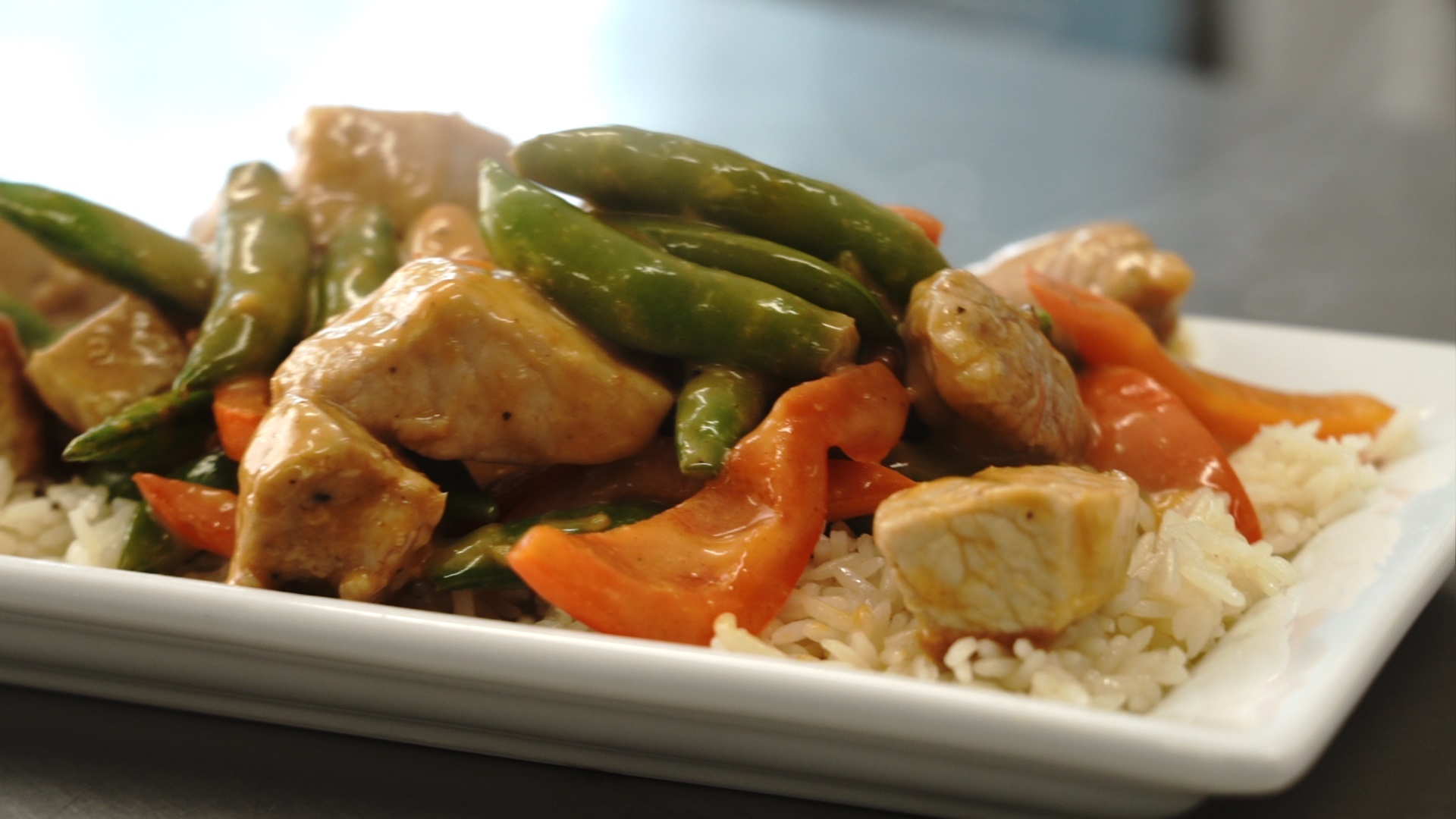 Thai coconut pork curry with vegetables served over rice