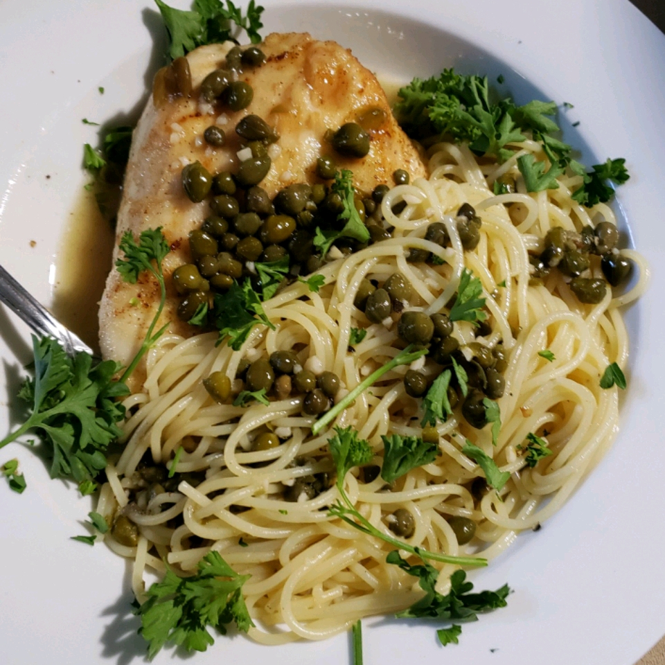 Chicken Piccata with Capers on a white plate
