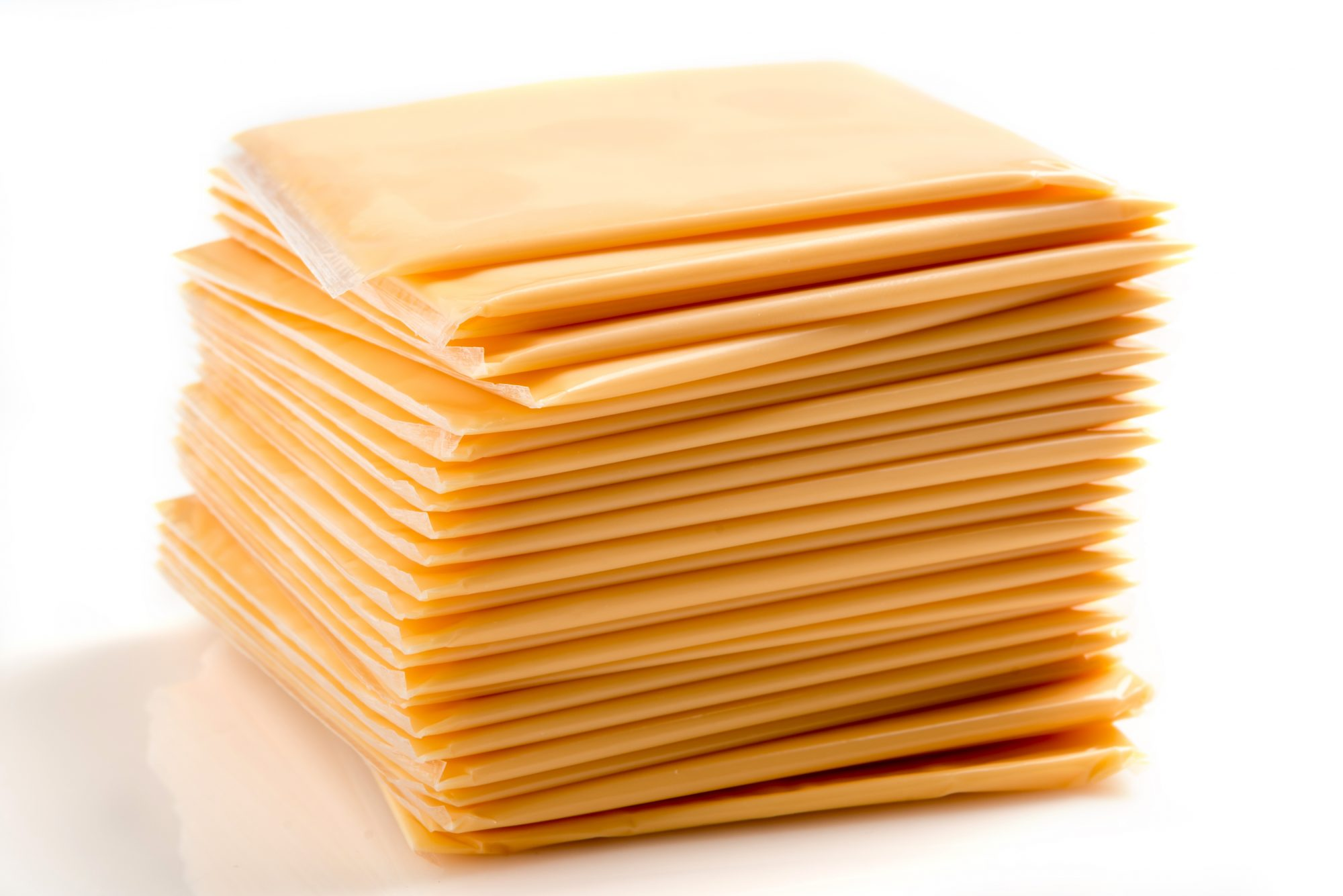 Heap of Sliced American Yellow Cheese