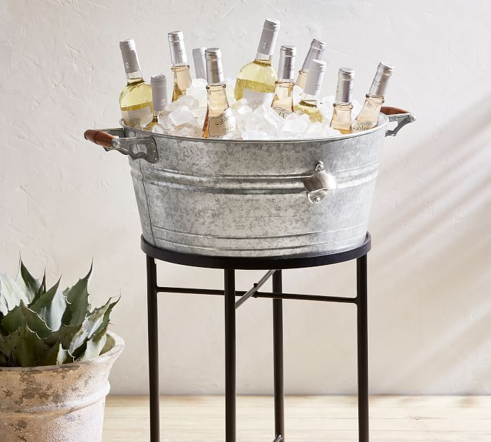 metal bucket holding ice and drinks on top of a stand