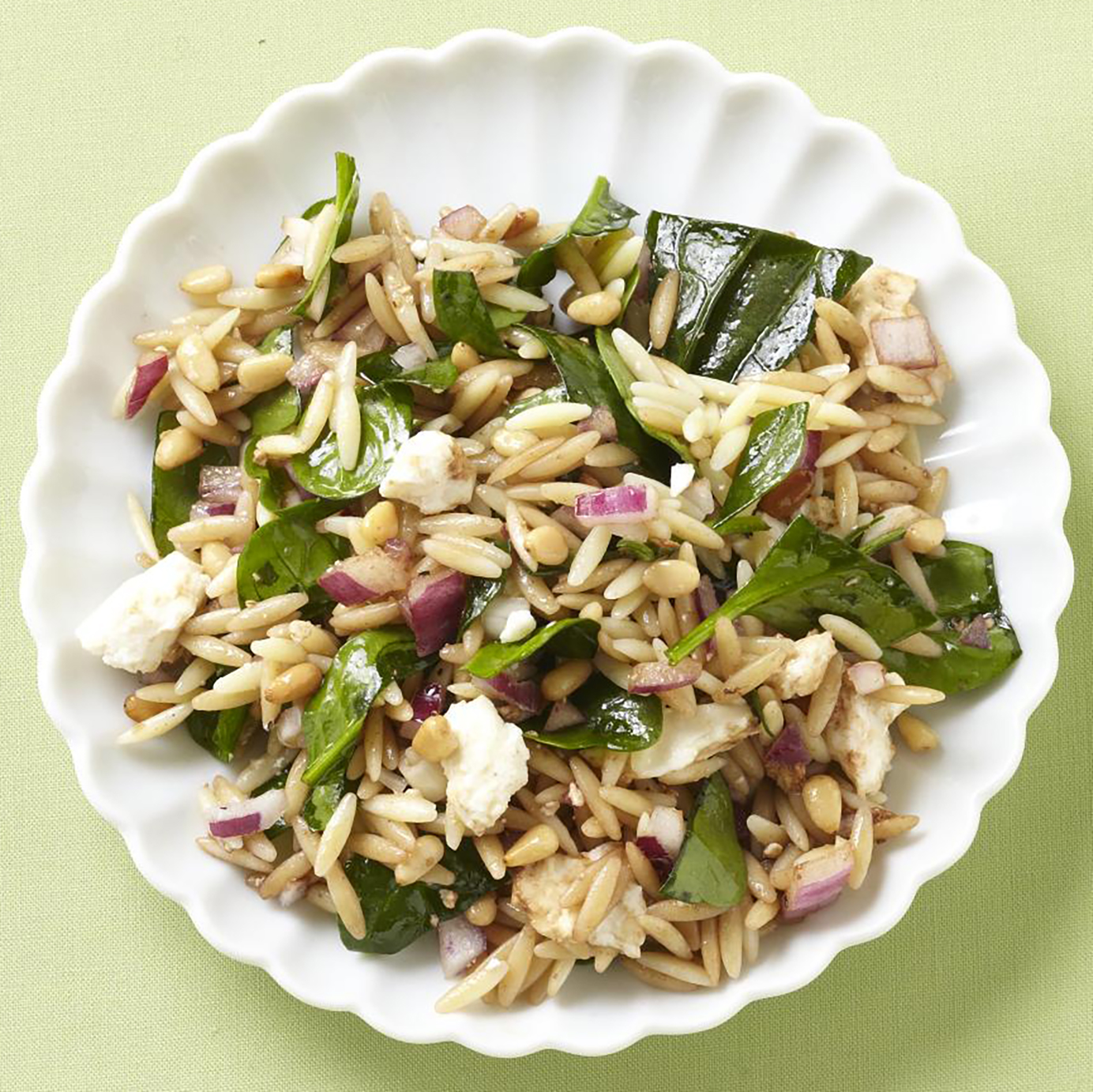 Spinach and Orzo Salad in a white bowl