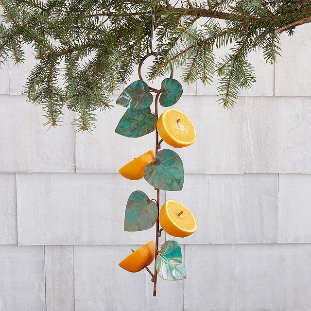 leave shaped bird feeder with orange halves attached