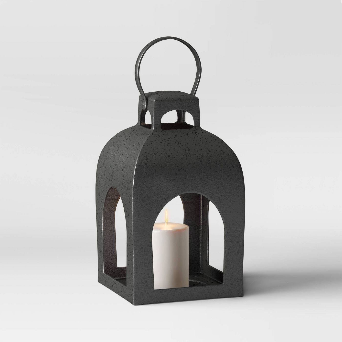 metal lantern with candle