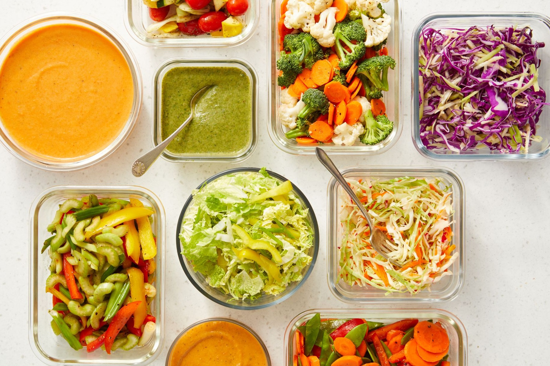 overhead shot of vegetable mixes, vegetable slaws, and vegetables sauces