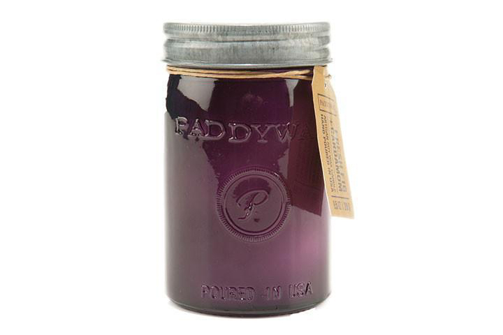 purple candle jar with aluminum lid on white background