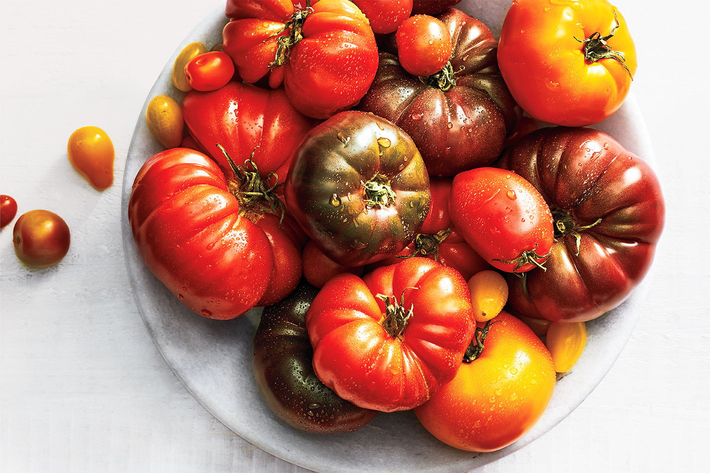 heirloom tomatoes on plate with water droplets on top