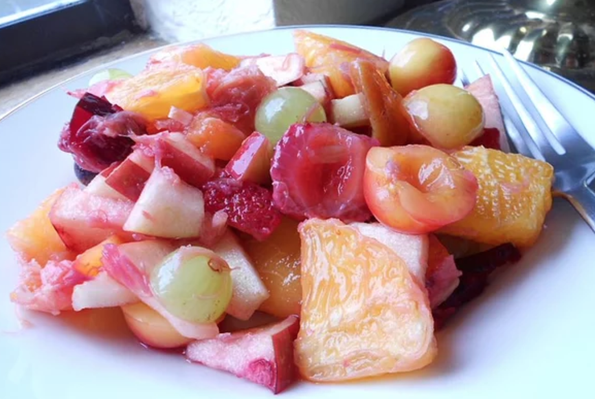 A simple rhubarb sauce (made with just chopped rhubarb, water, and sugar) is not only delicious, according to recipe creator CHMOORE, it keeps the other fruits from turning brown.