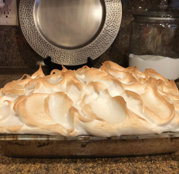 """How good is this recipe? Reviewer Rhiannon Diz-Rerunwon """"best dessert"""" at a rhubarb festival with the sweet, meringue-topped treat."""