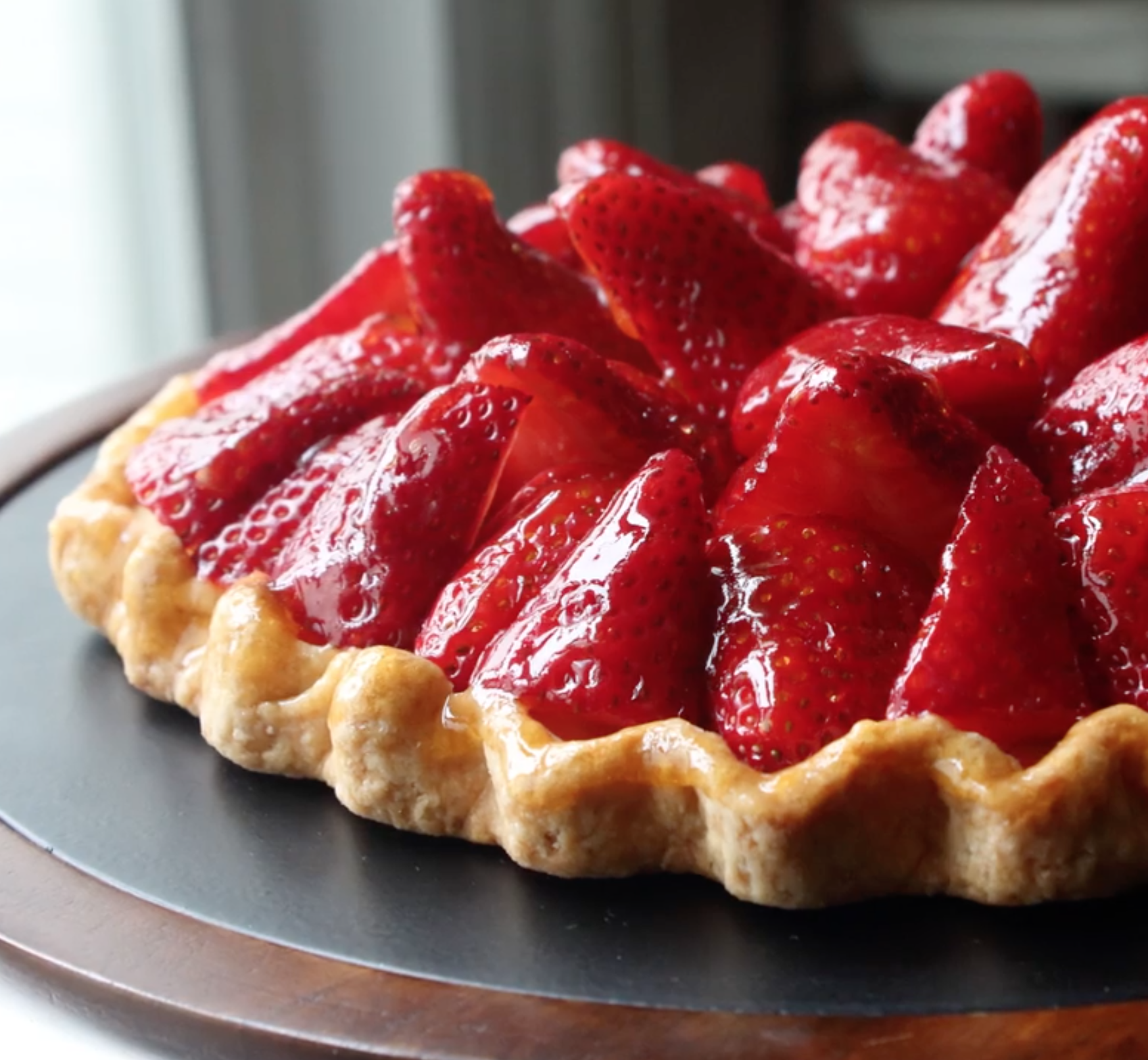Fresh Strawberry Tart side angle with glazed, glossy strawberries