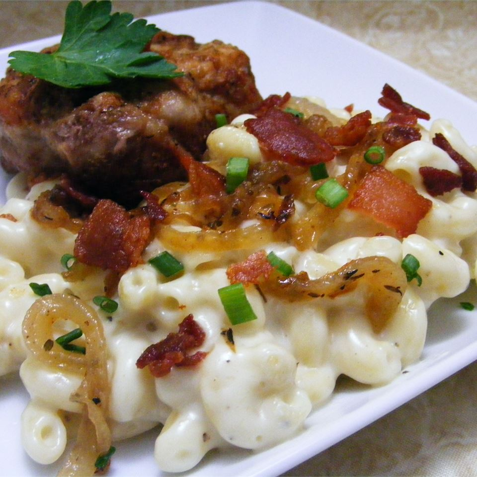 Macaroni and Cheese with Bacon and Onions on a white plate