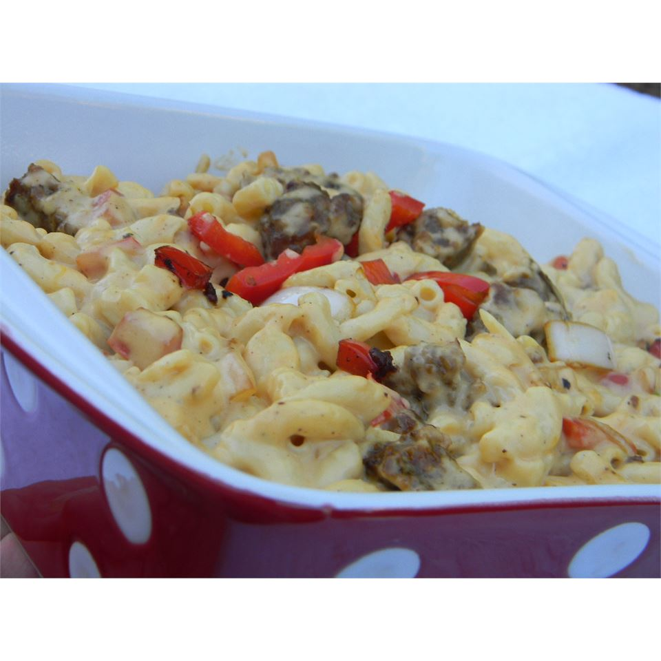 Macaroni and Cheese with Sausage, Peppers and Onions in a red dish