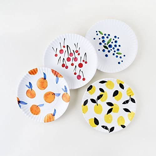 white plates with illustrated fruit designs