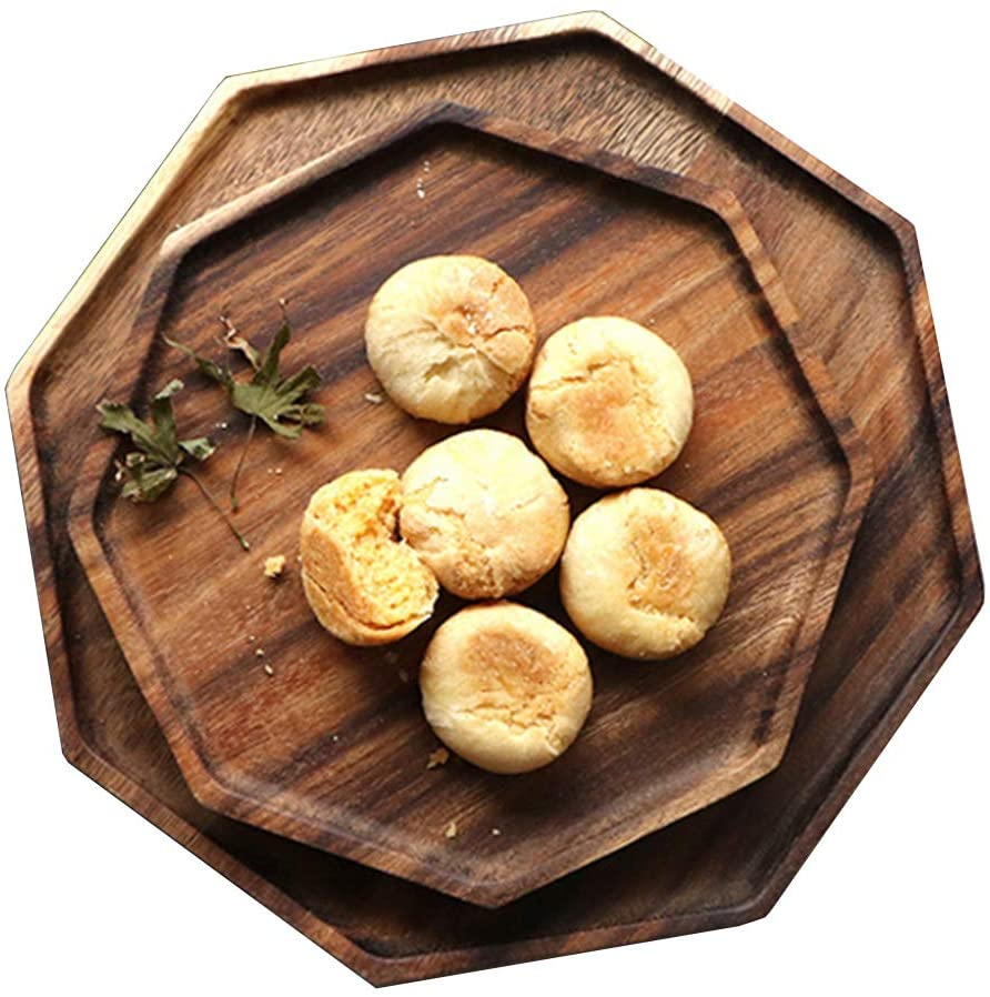 set of two wooden board trays with biscuits on top