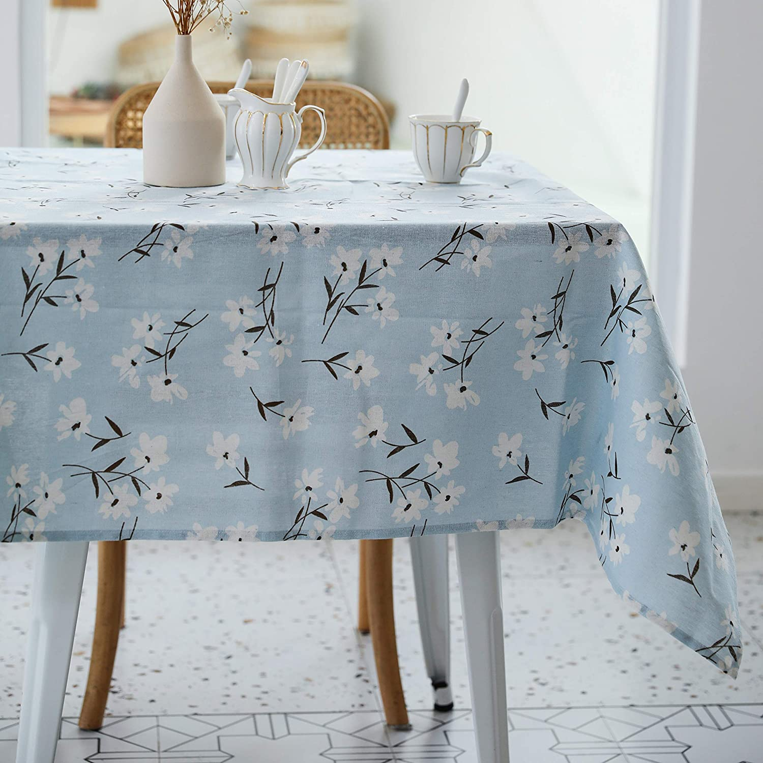 light blue tablecloth with floral print