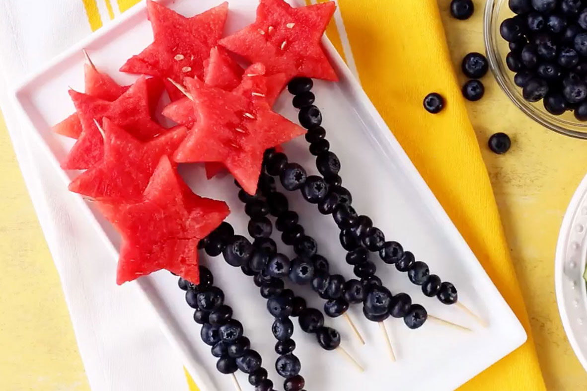 "Kids will have fun assembling these healthy and refreshing star-spangled treats. ""Don't cut the watermelon too thinly, otherwise the stars will break when you are trying to skewer them,"" suggests recipe creator sanne."
