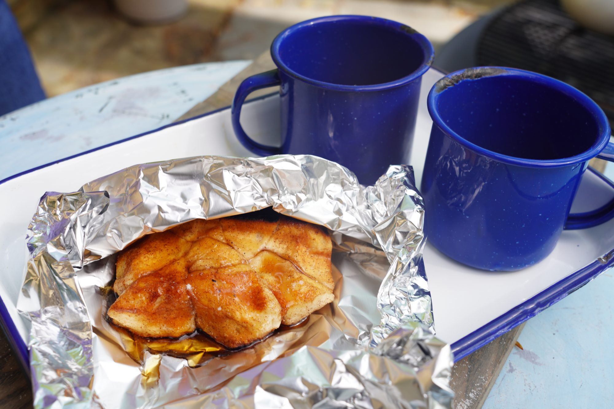 monkey bread foil packets drizzled with butter and maple syrup and served with coffee