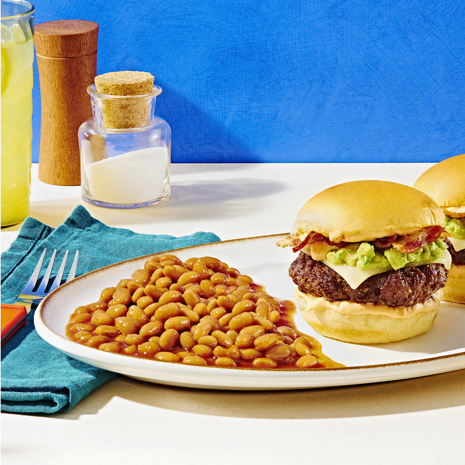 baked beans on a plate with a hamburger