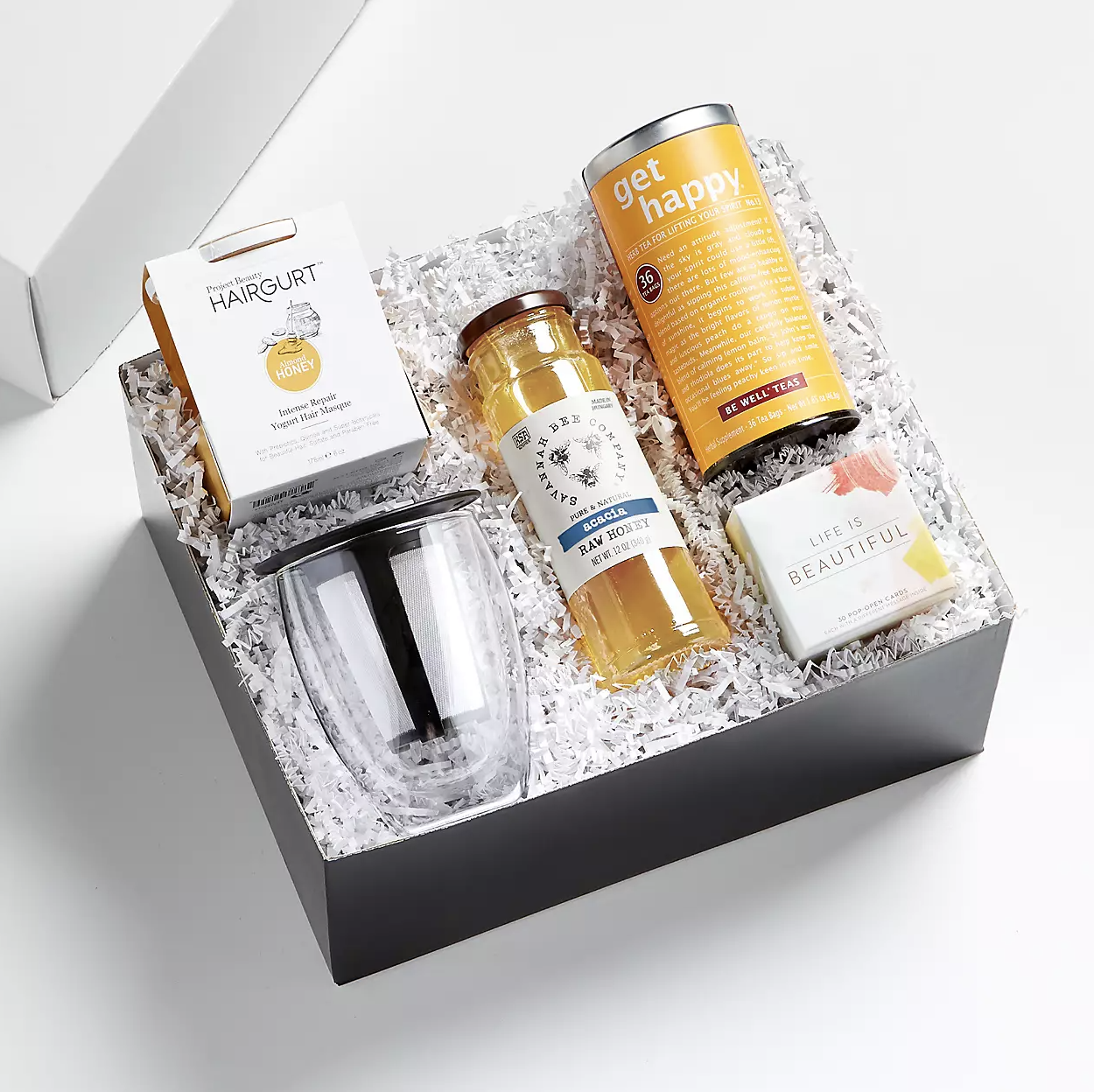 Refresh Gift Set - a gift box is filled with loose-leaf tea, a tea-straining mug, and other accessories for a tea-related gift