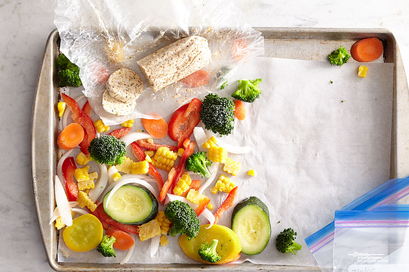 baking sheet with parchment paper and frozen vegetables