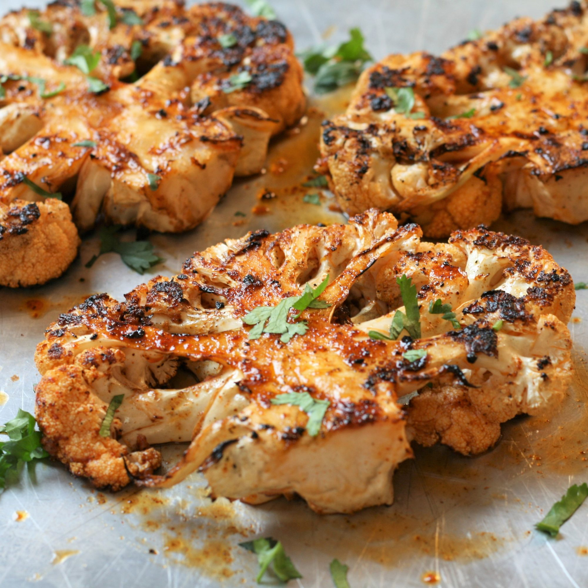 Grilled Cauliflower Steaks on a white plate