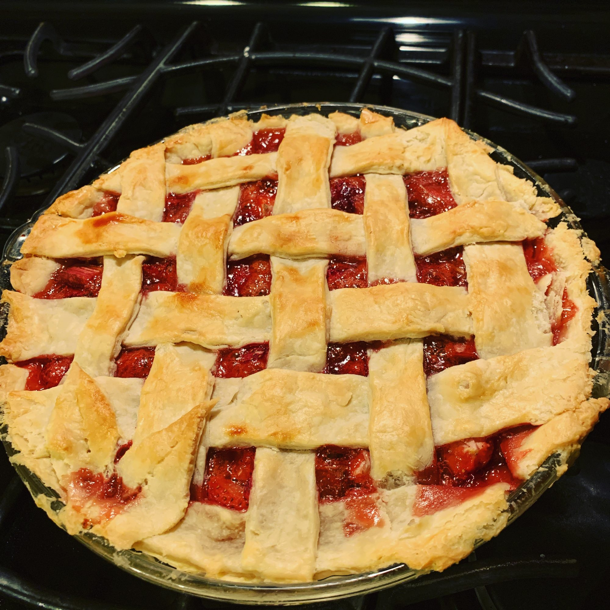 Strawberry Rhubarb Pie on a stovetop