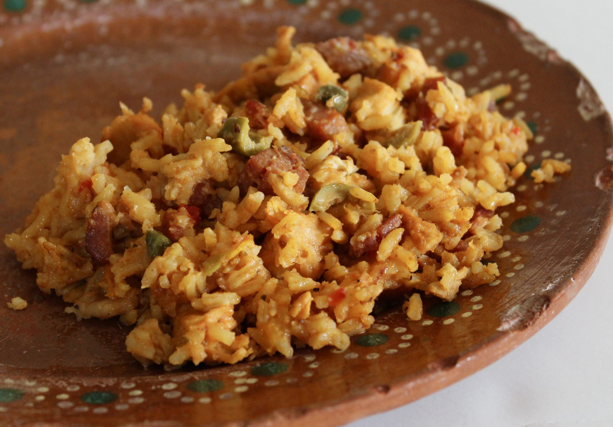 spanish rice with chicken on clay dish