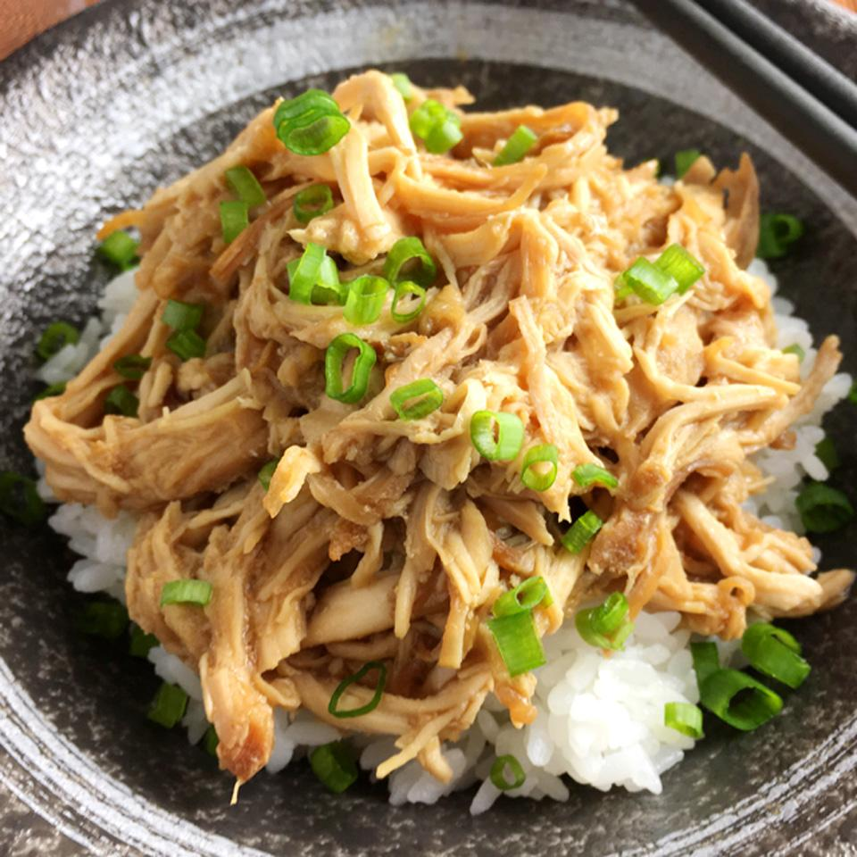 pulled chicken over rice with green onions