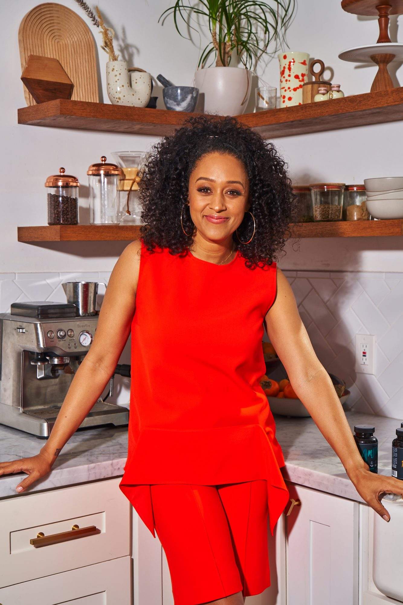 Tia Mowry standing in the kitchen