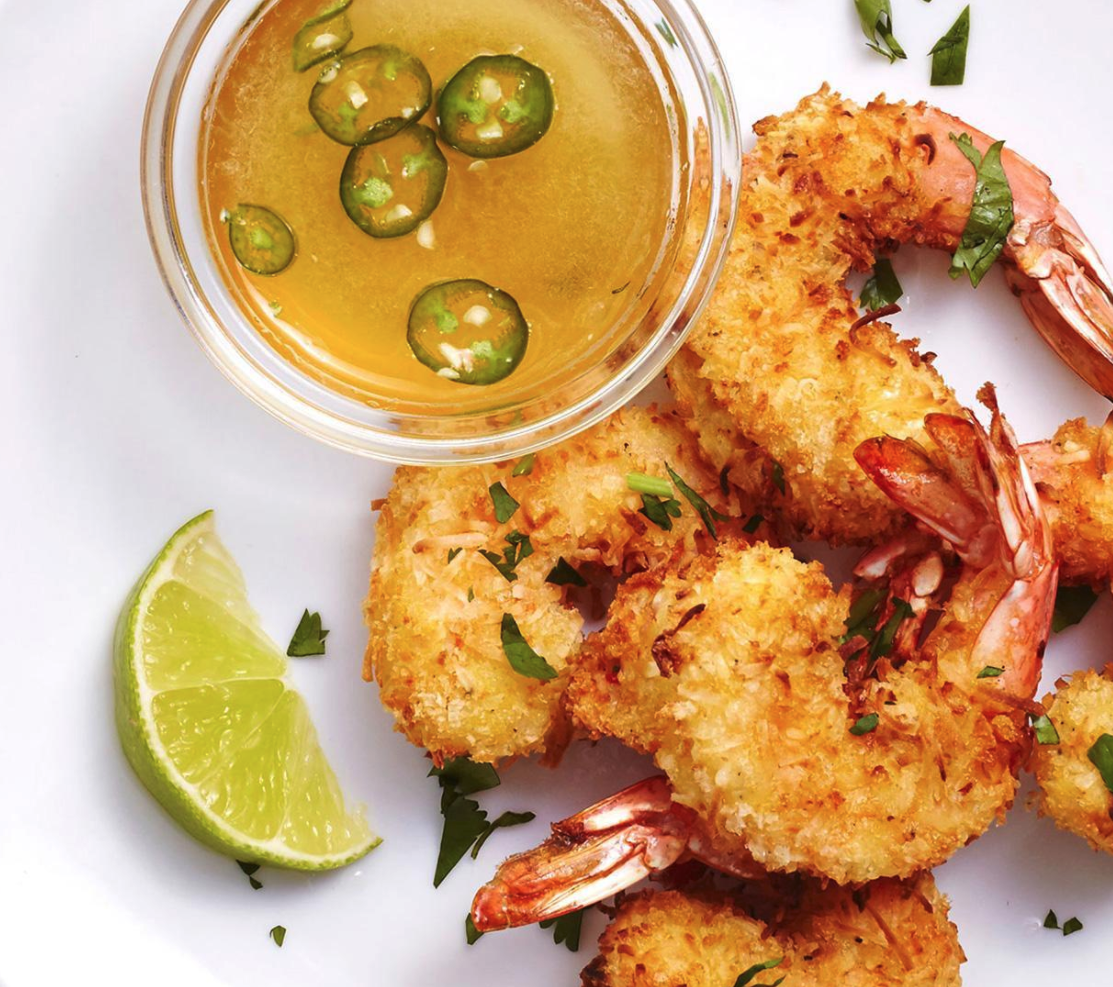 crispy air fried fryer coconut breaded shrimp with lime and jalapeno sauce