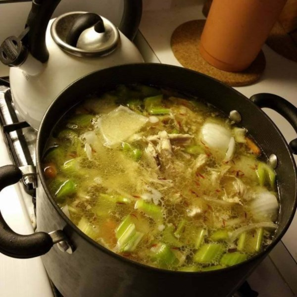 a pot of soup on the stove